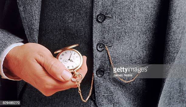Man checking his pocket watch