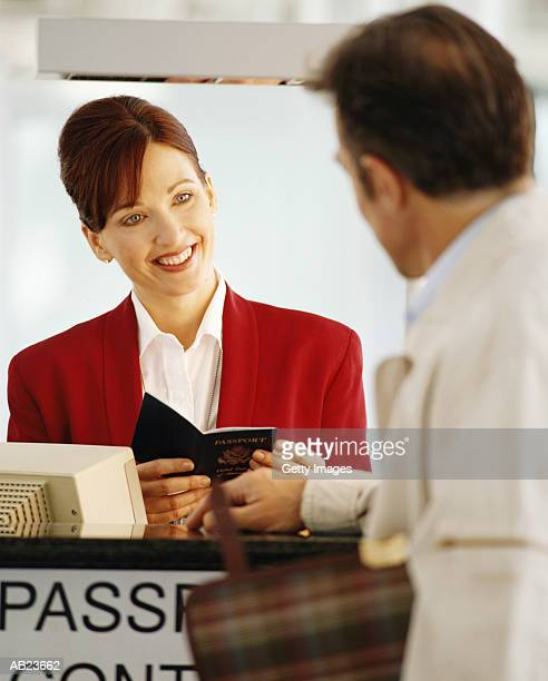 Man checking in at passport control