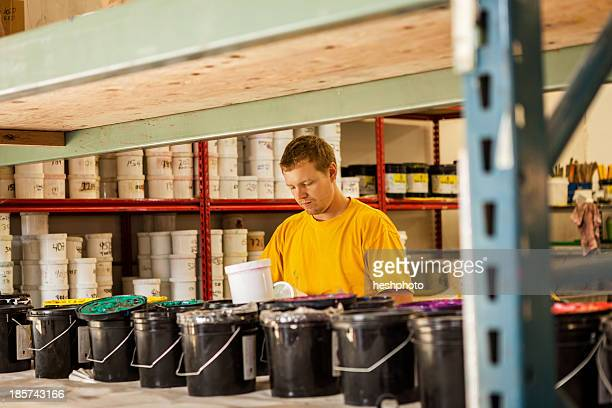 man checking ink in screen print workshop - heshphoto stock pictures, royalty-free photos & images