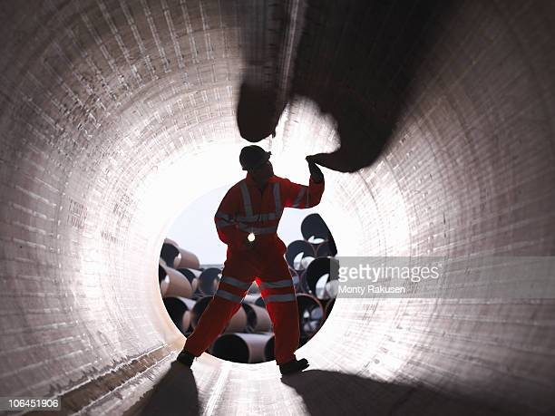 man checking pipes - monty shadow stock photos and pictures