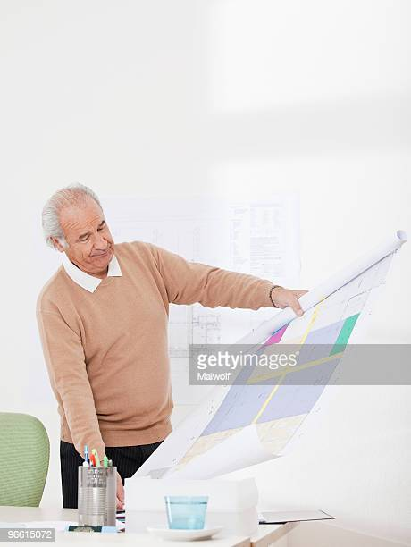 Man checking plan in an office