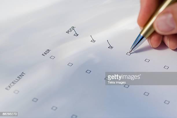 Man checking rating boxes