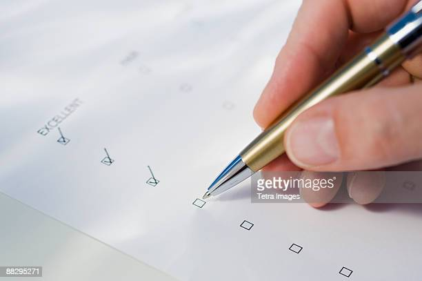 man checking rating boxes - survey stock photos and pictures