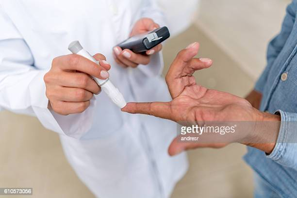 Man checking sugar level with glucometer