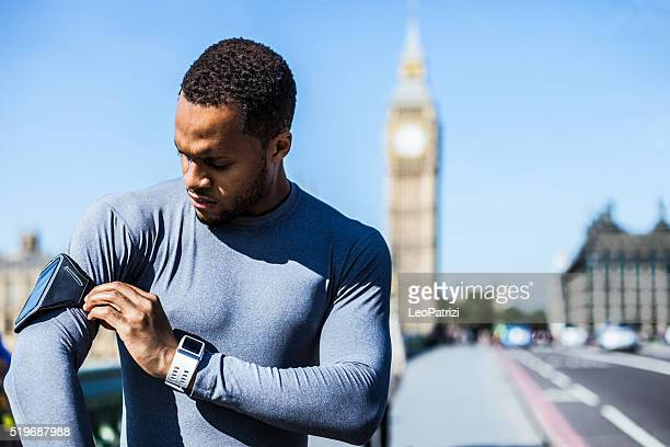 Man checking the time for a run in the city