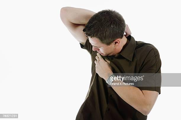 Man checking underarm
