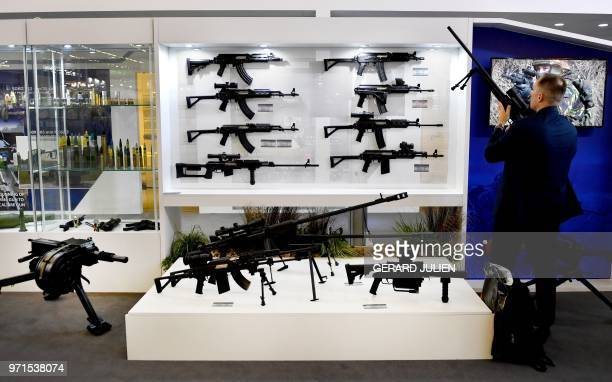 A man checks a machine gun manufactured by a Serbian company presented at the Eurosatory Defence and Security international exhibition in Villepinte...