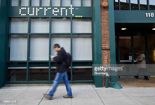A man checks a mobile device as he walks past Current TV LLC headquarters in San Francisco California US on Friday Jan 4 2013 Al Jazeera will pay...