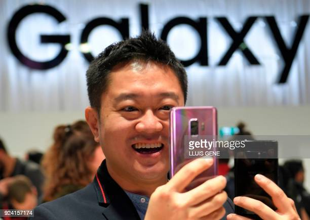 A man checks a new Samsung Galaxy S9 mobilephone during the Samsung Galaxy S9 Unpacked event on February 25 2018 in Barcelona on the eve of the...