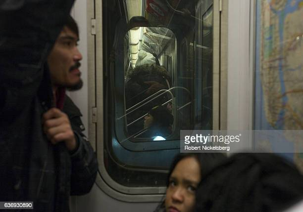 A man checks a route map while riding the subway December 20 2016 in New York City An average of 56 million people ride the New York City subway each...