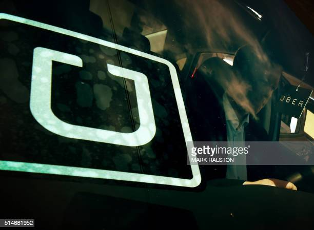 A man checks a vehicle at the first of Uber's 'Work On Demand' recruitment events where they hope to sign 12000 new driverpartners in South Los...