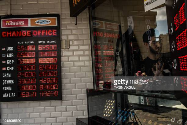A man checks foreign currency exchange rates inside a currency exchange shop on August 11 2018 in Istanbul President Recep Tayyip Erdogan vowed on...