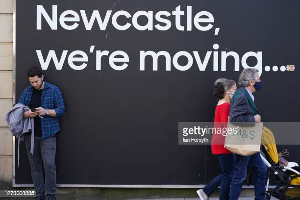 A man checks his phone as he leans against a sign in Newcastle city centre on September 17 2020 in Newcastle upon Tyne England Almost two million...