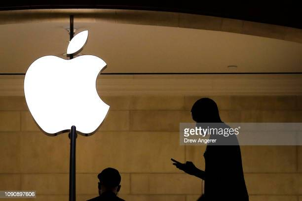Man checks his phone in an Apple retail store in Grand Central Terminal, January 29, 2019 in New York City. Apple is set to report first-quarter...