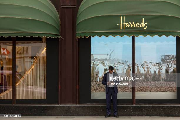 Man checks his phone outside the department store Harrods, near the home of Zamira Hajiyeva, the wife of Azerbaijan state banker Jahangir Hajiyev, on...