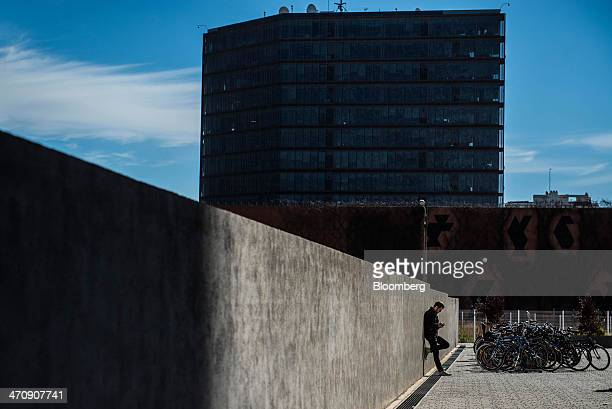 A man checks his smartphone at the @22 Innovation district in Barcelona Spain on Thursday Feb 20 2014 A smart city initiative which also involves...
