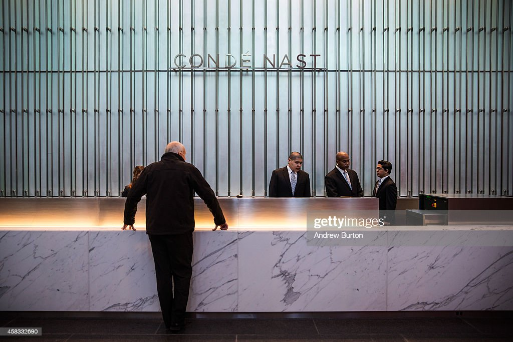 A man checks in to the front desk at One World Trade Center, which opens today, on November 3, 2014 in New York City. The skyscraper is 104 stories tall and cost $3.9 billion; it opens more than 13 years after the terrorist attacks of September 11, 2001, destroyed the original World Trade Center buildings. Officials say the building is currently at 60% occupancy, with Conde Nast as one of the first major tenants to move in.