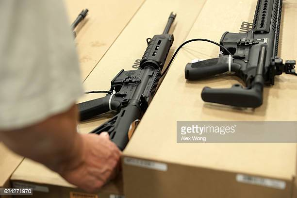A man checks out a rifle during the Nation's Gun Show November 18 2016 at Dulles Expo Center in Chantilly Virginia The show is one of the largest in...