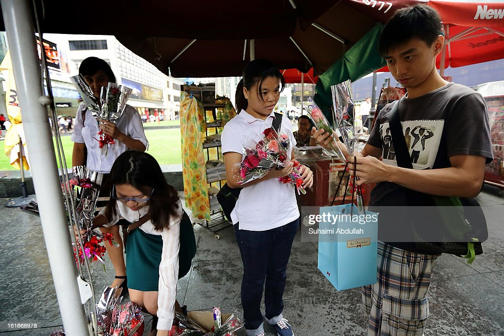 A man checks out the roses at Raffles Place during Valentine's Day on 14 February, 2013 in Singapore. Valentine's Day is a time to celebrate love, romance and friendship and is celebrated worldwide annually in different ways on February 14.