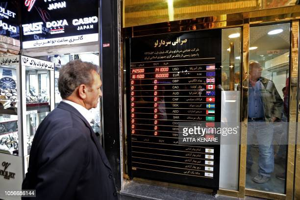 A man checks rates in front of a currency exchange shop in the Iranian capital Tehran's grand bazar on November 3 2018 Iran's supreme leader...