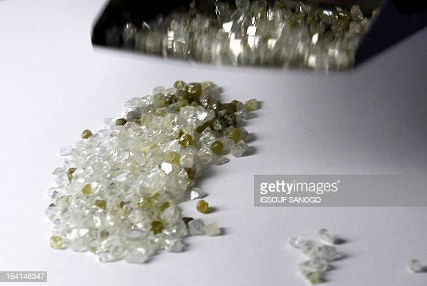 A man checks raw diamonds 10 August 2007 at Gold and Diamond department of Sierra Leone Central Bank in Freetown The first Sierra Leonean diamond was...