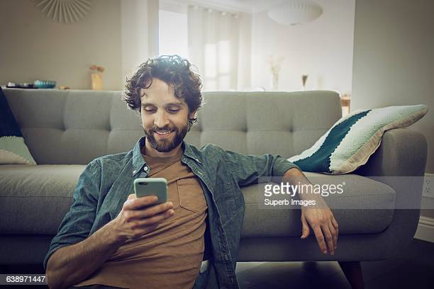 man checks smartphone - men stock pictures, royalty-free photos & images
