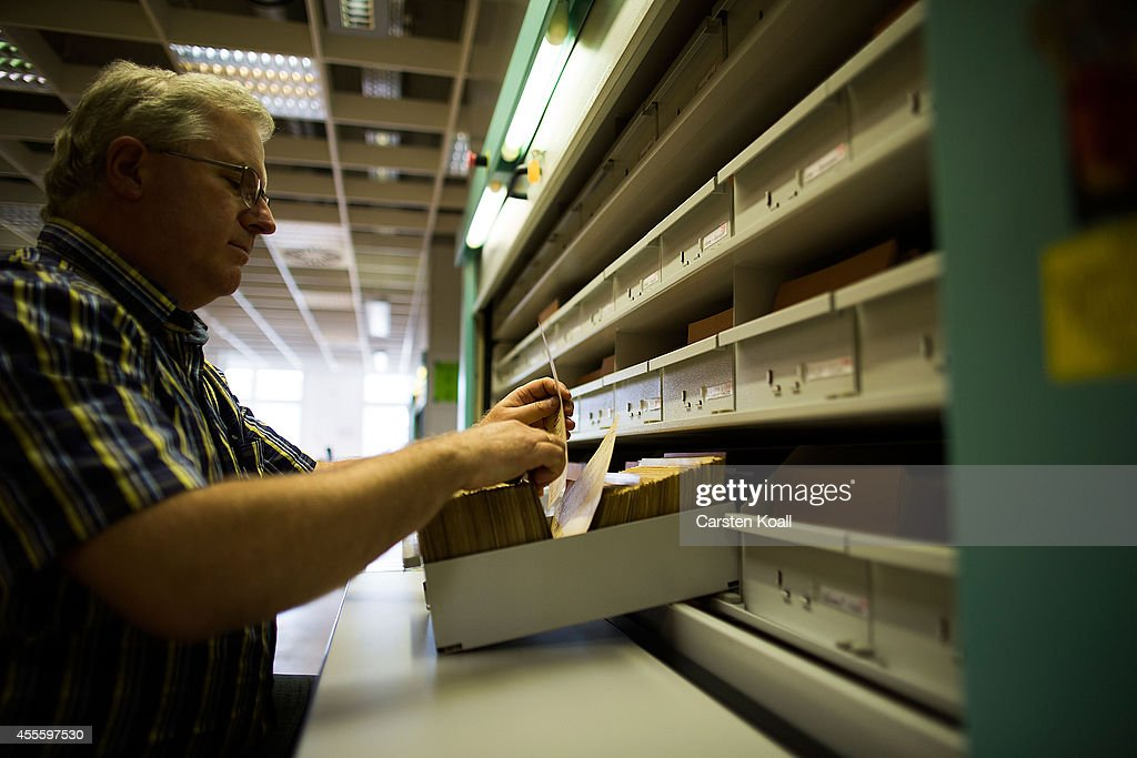 A man checks the documents at the archives of the former East German secret police, known as the Stasi, on September 17, 2014 in Berlin, Germany. The Stasi, whose official function was to protect the East German communist party, pursued an extremely aggressive campaign of spying on East German citizens in order to confine and root out dissent. The archive contains information gathered by the Stasi on millions of people. This November Germany will commemorate the 25th anniversary of the fall of the Berlin Wall which led to the demise of communist East Germany.