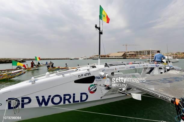 A man checks the last details on the Row4ocean rowing trimaran before leaving Dakar to cross the Atlantic on December 14 2018 A rowing trimaran took...