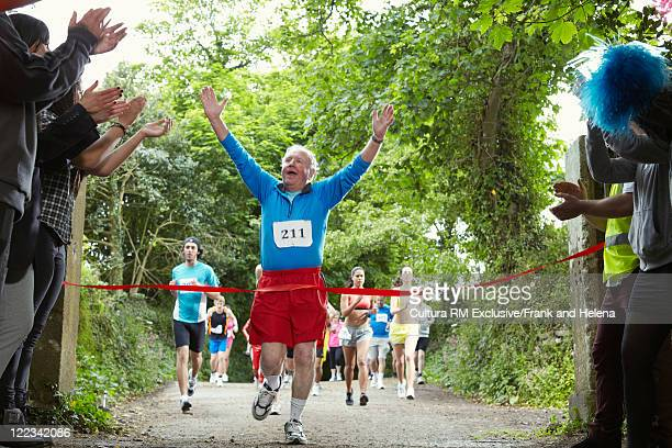 Man cheering and finishing marathon