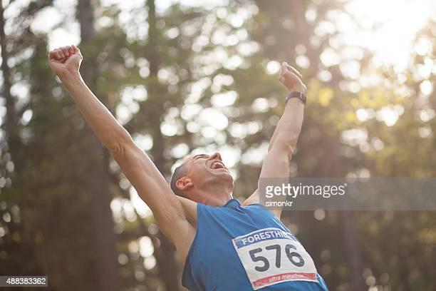 Man cheering during ultramarathon race