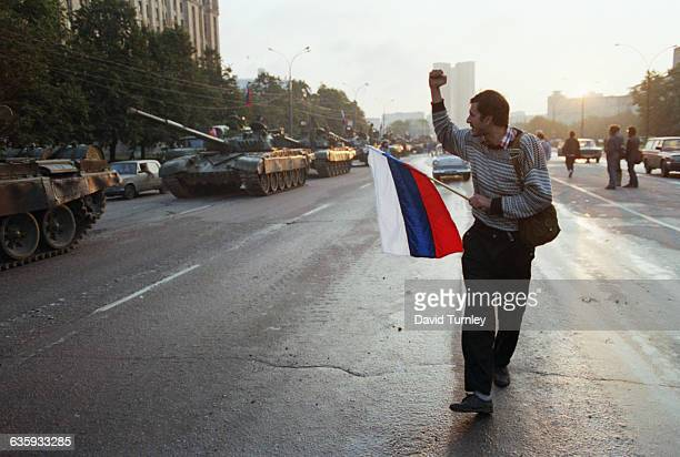 Man Cheering Passing Tanks
