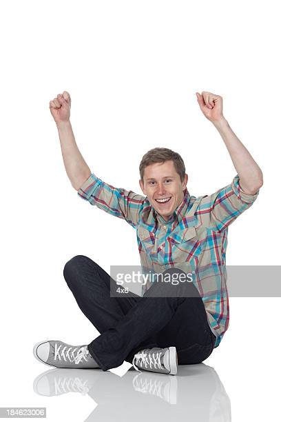 Man cheering with arms raised