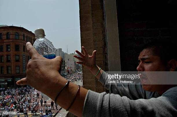 A man cheers on marchers as hundreds of thousands of immigrants demonstrate on May 1 2006 in downtown Los Angeles California The demonstration called...