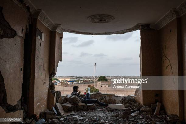 A man chews khat on the fourth floor of the destroyed Emirates Hotel on September 17 2018 in Aden Yemen Aden the wartime base of Yemen's Saudiled...