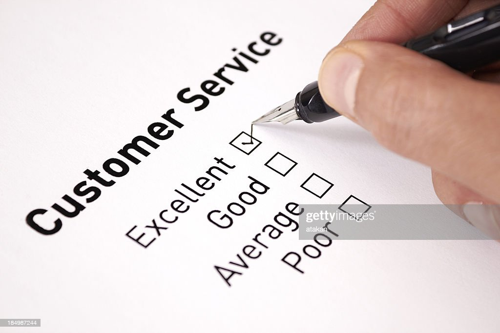 A man chooses excellent on a customer service survey : Stock Photo