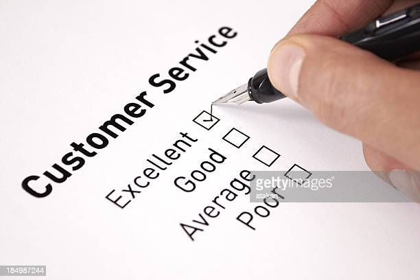 a man chooses excellent on a customer service survey - perfection stock pictures, royalty-free photos & images