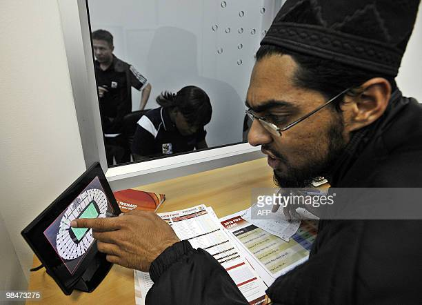 A man chooses for seats on a screen as he purchases official 2010 FIFA World Cup tickets at a booking office on April 15 2010 at the Maponya shopping...