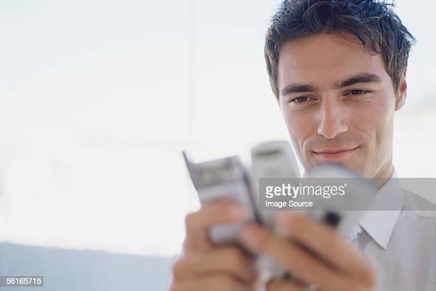 Man choosing between mobile phones