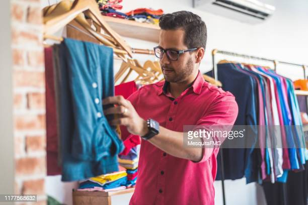 man choosing clothes - men fashion stock pictures, royalty-free photos & images