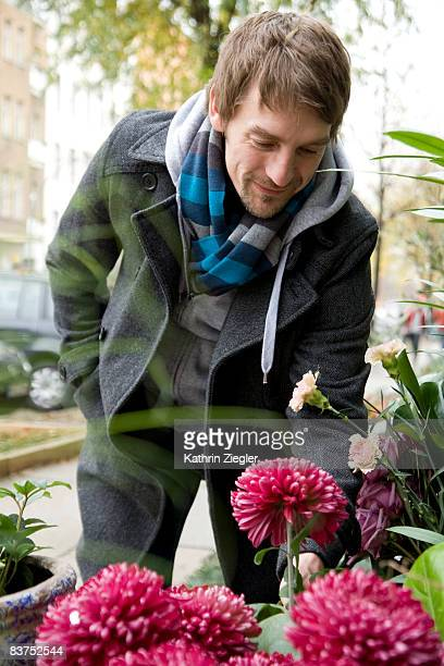 man choosing flowers at flower shop
