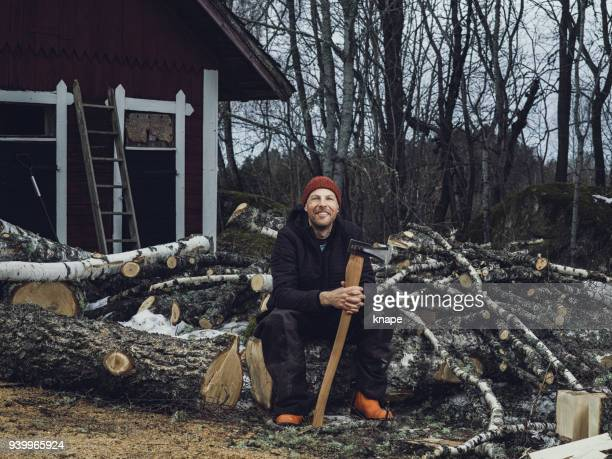man chopping cleaving doing wood work outside woodcutter/lumberjack - chopping food stock pictures, royalty-free photos & images