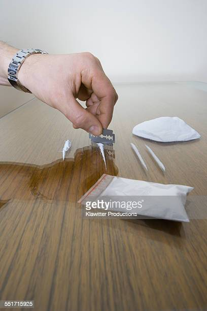 Man Chopping Lines of Cocaine
