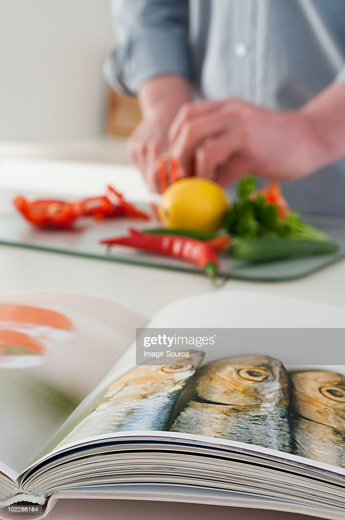Man chopping peppers : Stock Photo