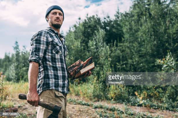 man chopping wood in rural landscape - chop stock pictures, royalty-free photos & images