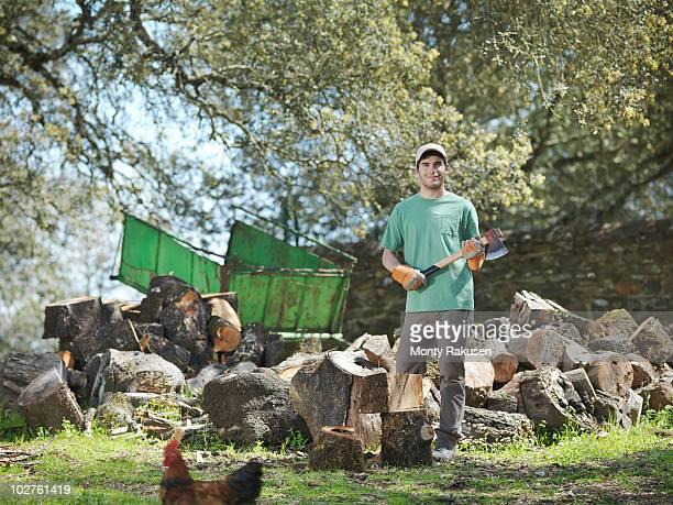 Man chopping wood on farm