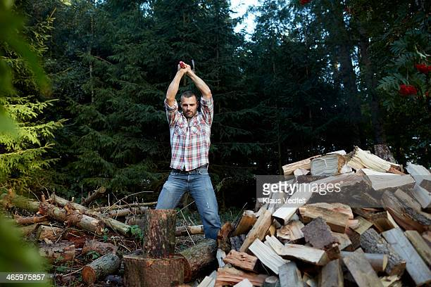 Man chopping wood with axe