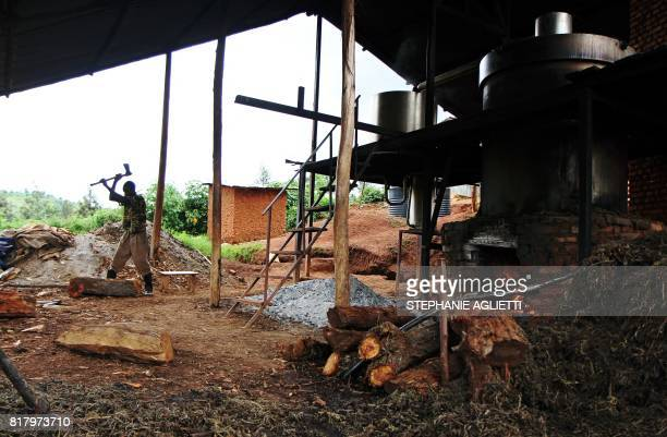A man chops wood at a small factory in Gahara in the Southeast of Rwanda on April 28 2017 Last year Rwanda exported around 14 tonnes of essential...