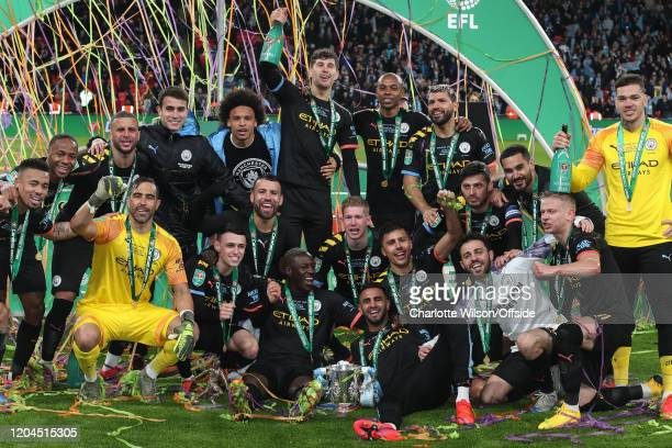 Man City celebrate winning the trophy during the Carabao Cup Final between Aston Villa and Manchester City at Wembley Stadium on March 1 2020 in...