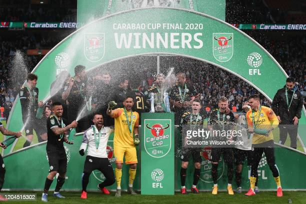 Man City celebrate with the trophy during the Carabao Cup Final between Aston Villa and Manchester City at Wembley Stadium on March 1, 2020 in...