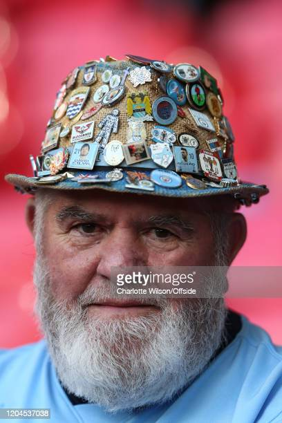 Man City fan with a hat covered in pins during the Carabao Cup Final between Aston Villa and Manchester City at Wembley Stadium on March 1, 2020 in...
